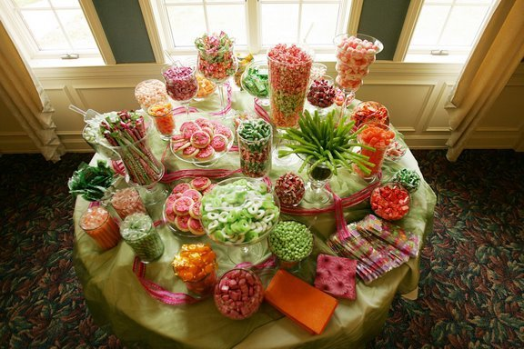 A beautiful wedding candy buffet doubles as a wedding favor for Candy bar for weddings receptions