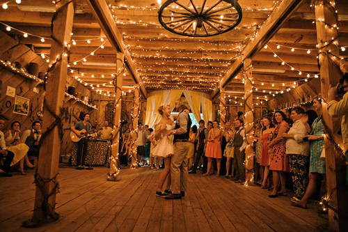 barn wedding lights Photo Credit Josh Goleman