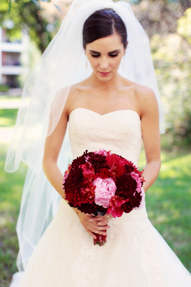 Bride with red bouquet