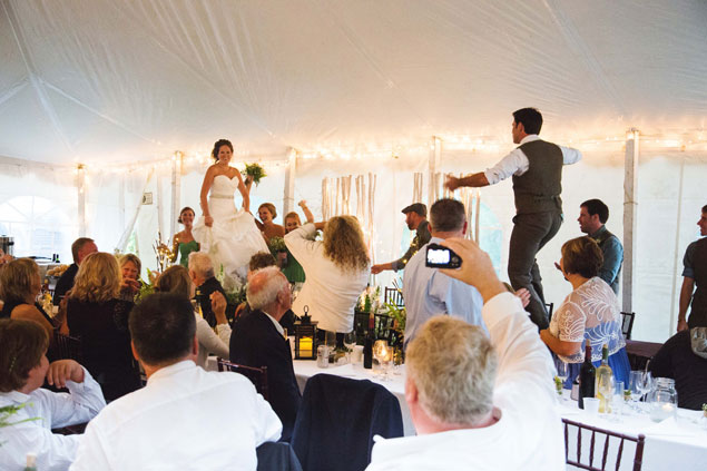 Bride and Groom Dancing on Tables